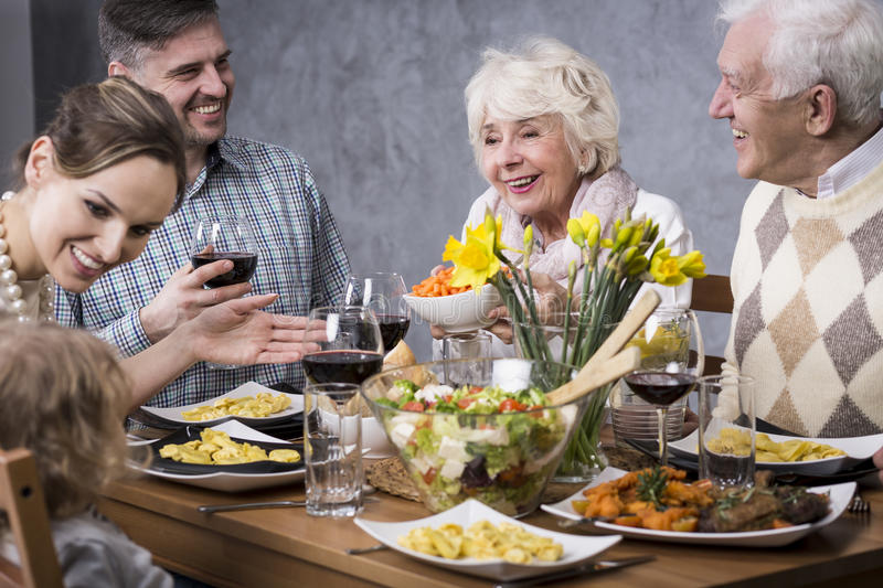 Download Family Gathered At The Dinner Table Stock Image   Image Of Small,  Family: