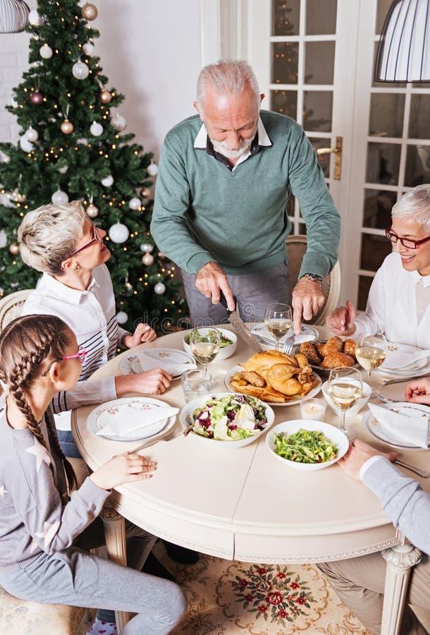 Family gathered over Christmas holidays, celebrating, having lunch royalty free stock photo