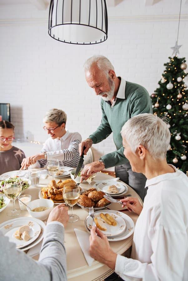 Family gathered over Christmas holidays, celebrating, having lunch royalty free stock photography