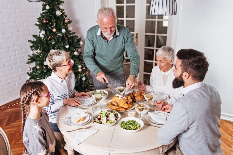 Family gathered over Christmas holidays, celebrating, having lunch royalty free stock photos