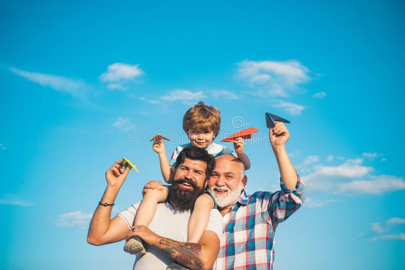 Family generation: future dream and people concept. Boy with father and grandfather. Generations men. Dream of flying. Family generation: future dream and stock photography