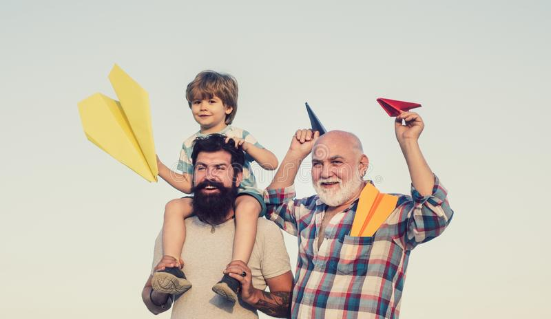 Family generation: future dream and people concept. Boy with father and grandfather. Happy fathers day. royalty free stock images