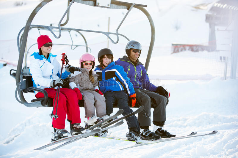 Download Family Getting Off Chair Lift On Holiday Stock Photo - Image of cold, action: 25838434