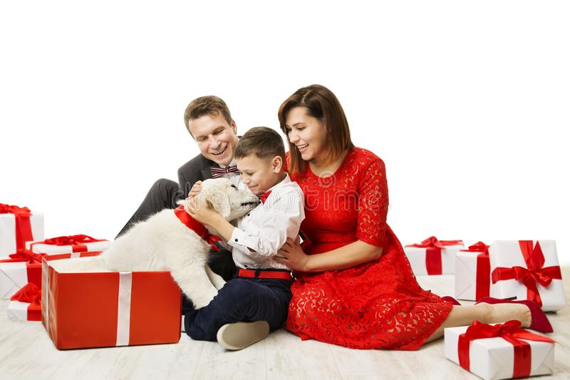 Family Gives Dog In Present Gift to Child, Father Mother Child Pet stock photos