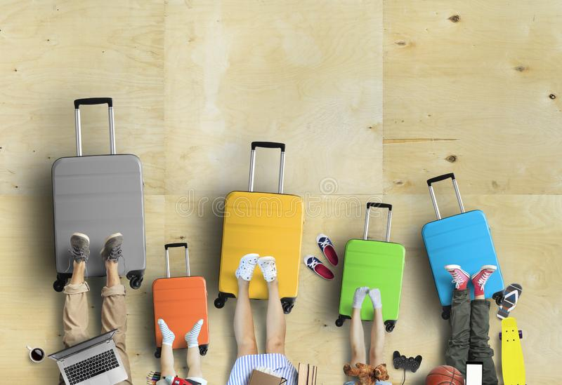 Family is going on a trip, five colored suitcases with clothes and accessories stock photography