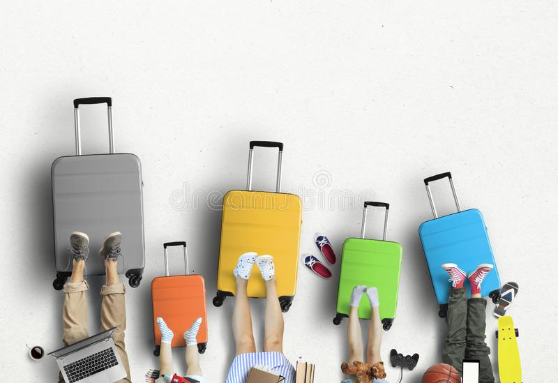 Family is going on a trip, five colored suitcases with clothes and accessories royalty free stock photography