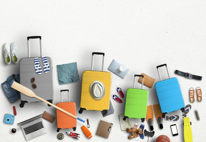 Family is going on a trip, five colored suitcases with clothes and accessories royalty free stock image