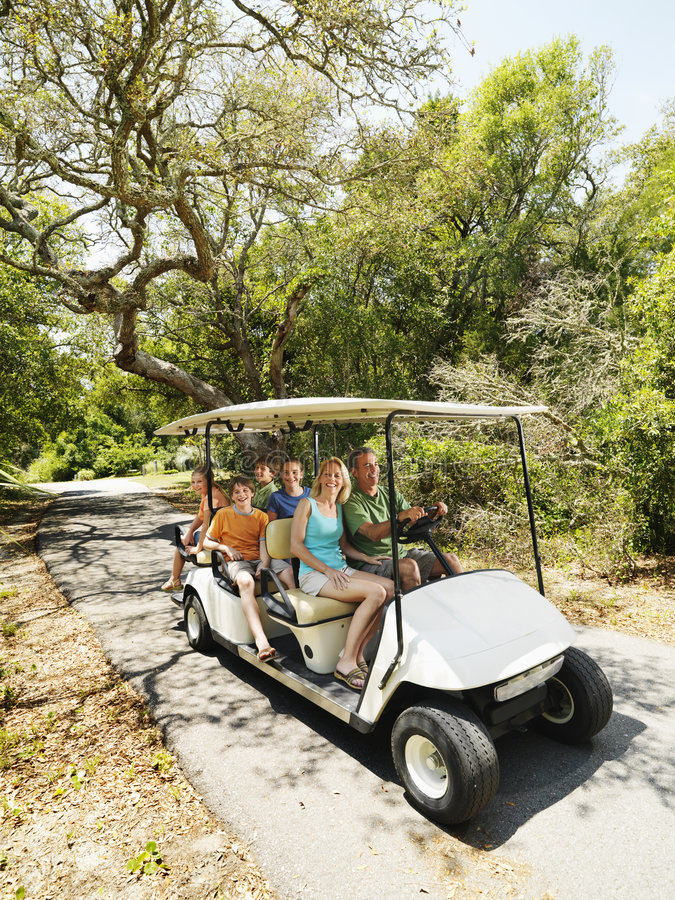 Family in golf cart. stock photo