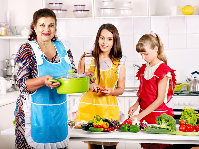 Family with grandmother and child at kitchen. Family with grandmother and child cooking at kitchen stock image