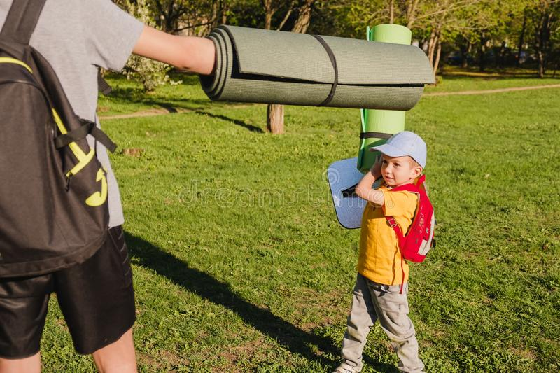 Family grass boy brother park. happy outside royalty free stock images