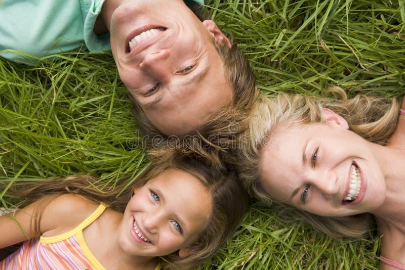 family grass lying smiling