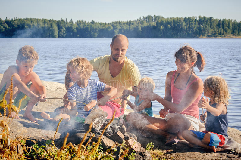 Family grilling together royalty free stock photography