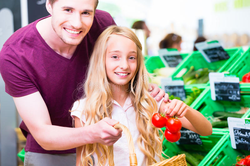 Family grocery shopping in corner shop stock photo