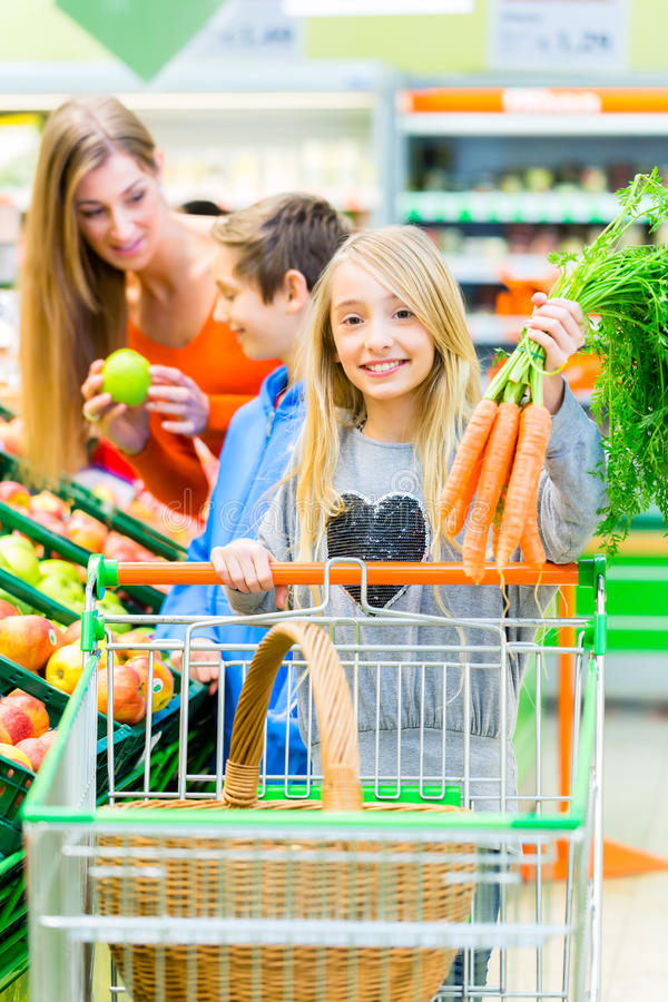Family grocery shopping in hypermarket stock photos