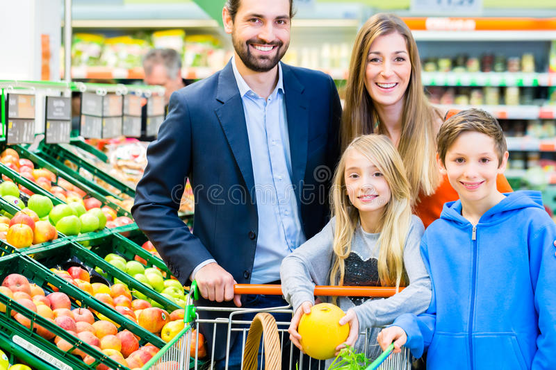 Family grocery shopping in hypermarket royalty free stock images