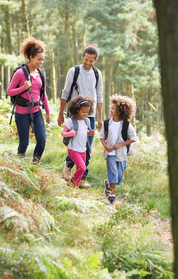 Family Group Hiking In Woods Together stock photos
