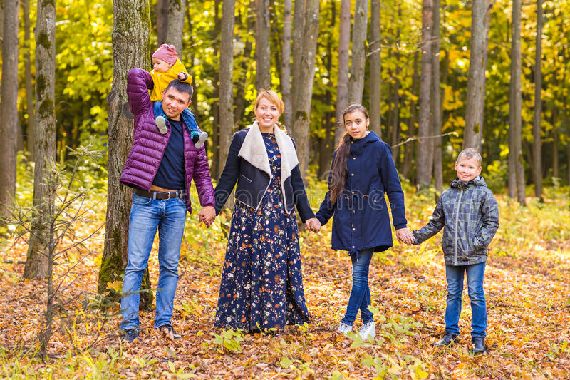 Family Group Relaxing Outdoors In Autumn Landscape stock photos