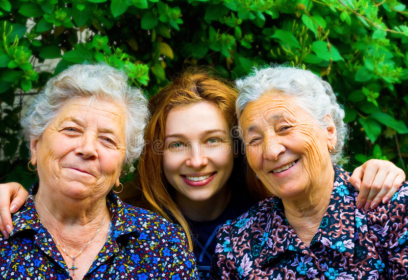 Family group - two senior ladies and young woman. Happy family - young woman and two senior ladies stock image