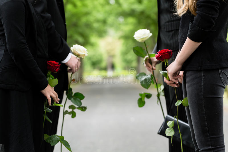 Family in guard of honor at funeral stock photo