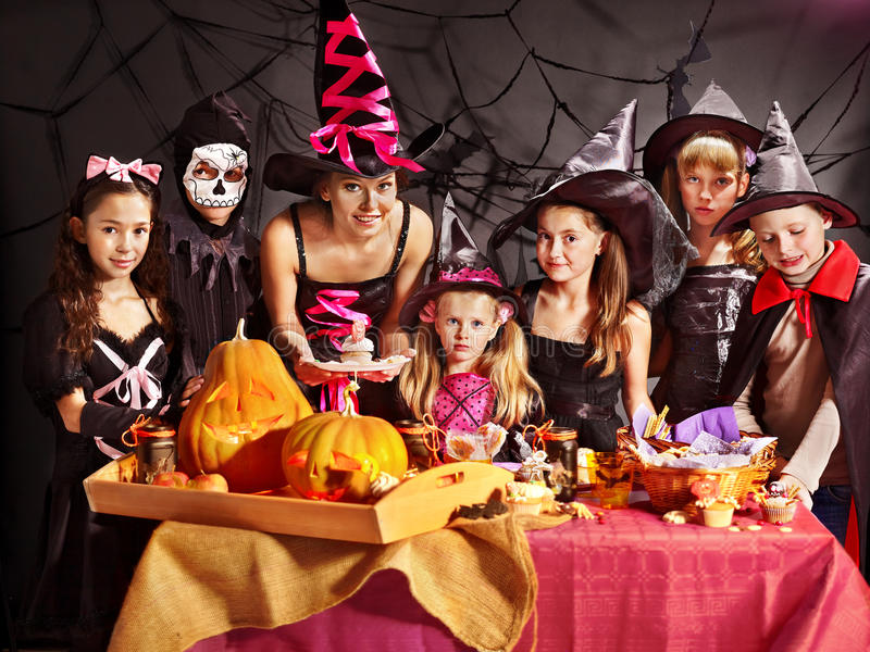 Family on Halloween party with children. stock photos
