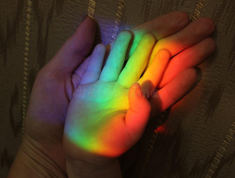 Family hands and rainbow royalty free stock photos
