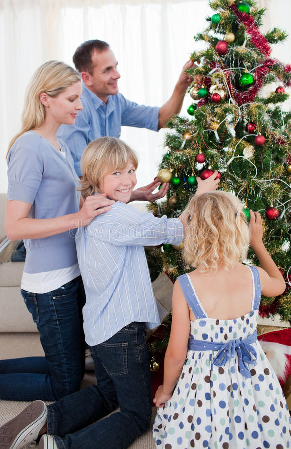 Download Family Hanging Decorations On A Christmas Tree Stock Image - Image: 11943473