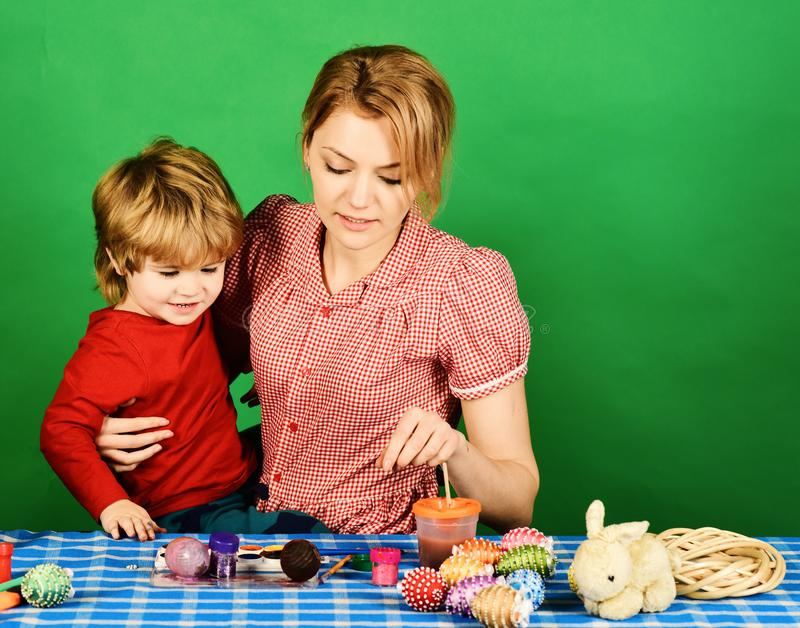 Family happiness and Easter celebration concept. Woman and little boy royalty free stock images