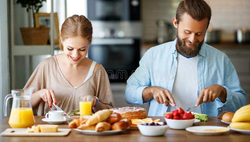 Family happy couple have Breakfast in kitchen in morning. Family happy couple have Breakfast in the kitchen in morning royalty free stock images