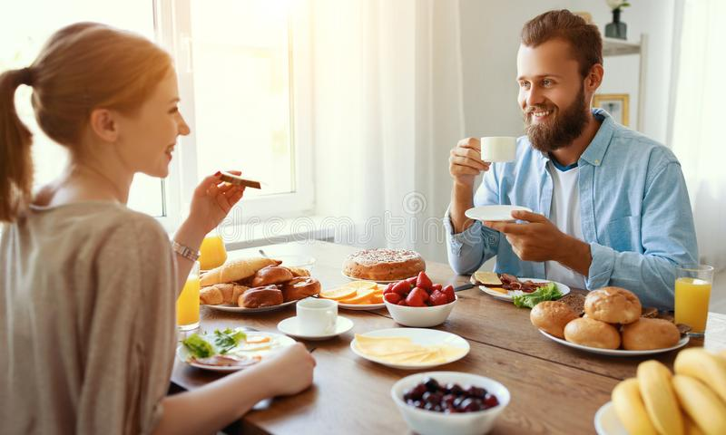 Family happy couple have Breakfast in kitchen in morning. Family happy couple have Breakfast in the kitchen in morning stock image
