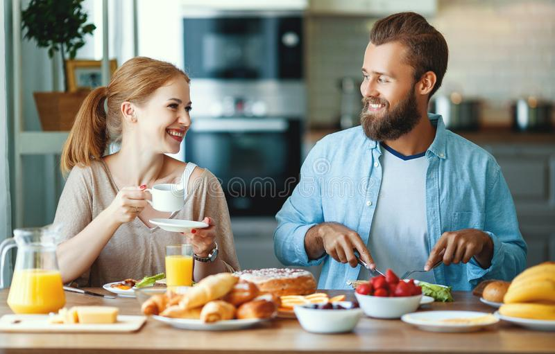 Family happy couple have Breakfast in kitchen in morning. Family happy couple have Breakfast in the kitchen in morning royalty free stock photos