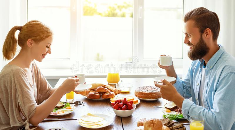 Family happy couple have Breakfast in kitchen in morning. Family happy couple have Breakfast in the kitchen in morning royalty free stock image