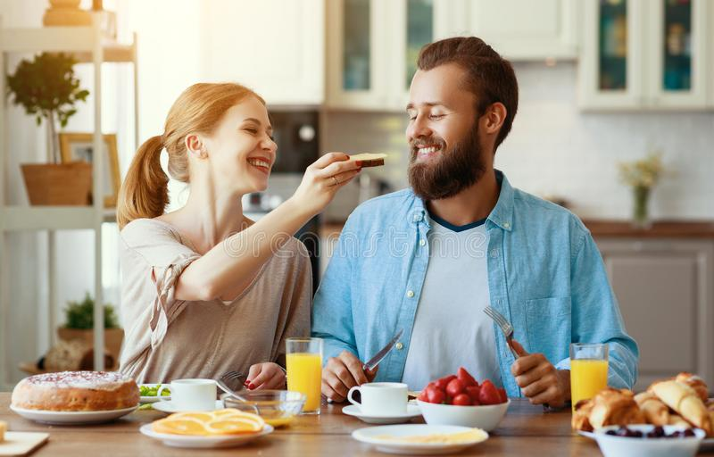 Family happy couple have Breakfast in kitchen in morning. Family happy couple have Breakfast in the kitchen in morning stock photos