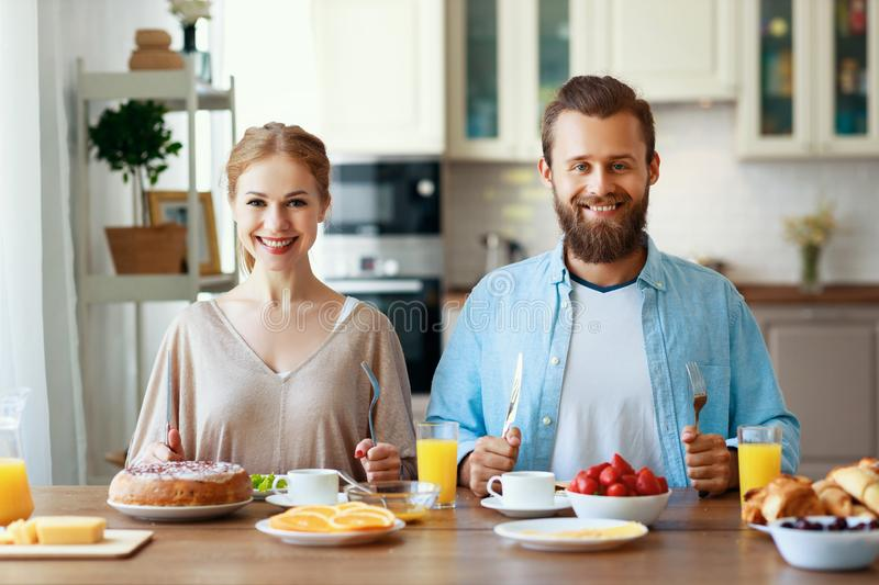 Family happy couple have Breakfast in kitchen in morning. Family happy couple have Breakfast in the kitchen in morning stock photography