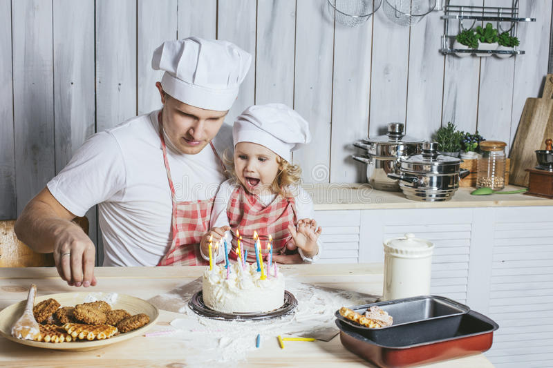 Family, happy daughter with my dad at home in the kitchen laugh royalty free stock images