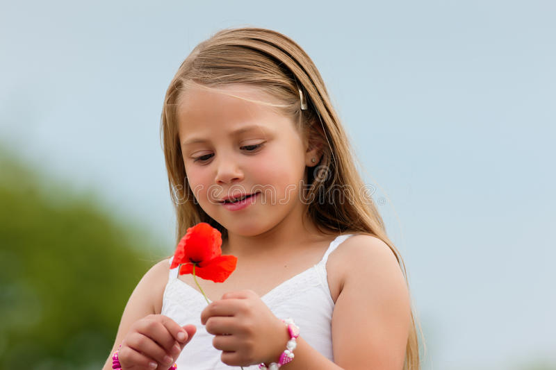 Download Family - Happy Girl With Corn Poppy Stock Photo - Image: 20721512