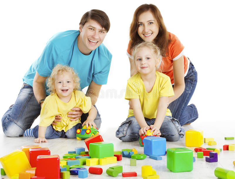 Family with Happy Kids Playing Building Blocks, Parents Children. Family with Happy Kids Playing Building Blocks, Two Parents with Children Play Toys over White royalty free stock photography