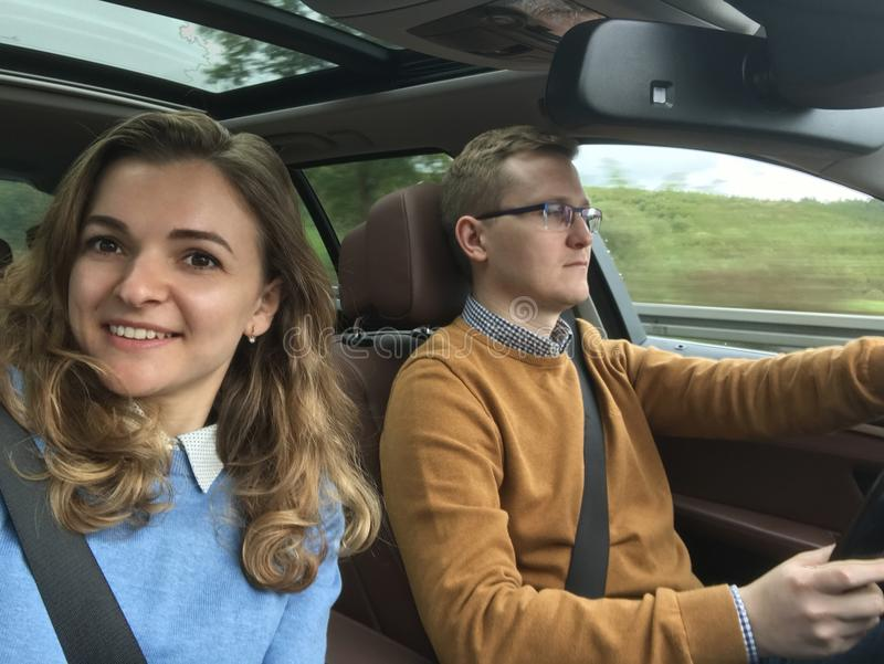 Happy selfie photo in modern car during vacation stock photography