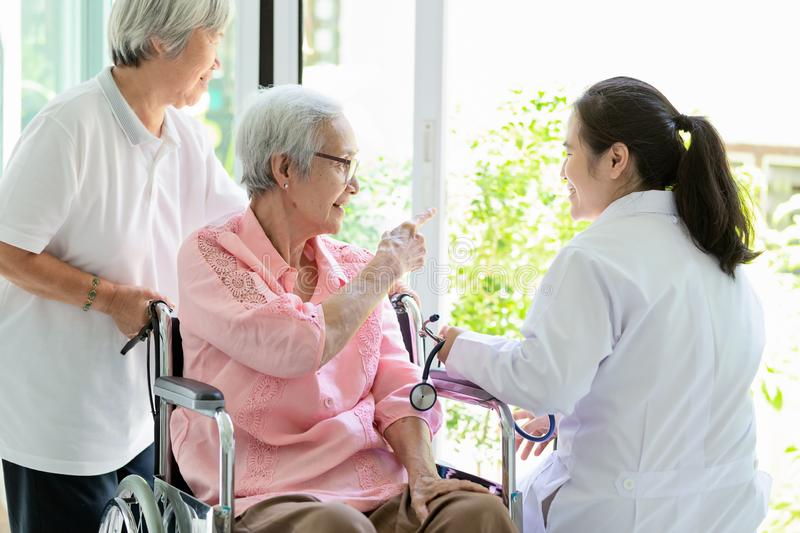 Family happy senior asian woman and doctor or nurse talking,enjoying together,female caregiver or friendship supporting smiling stock photo