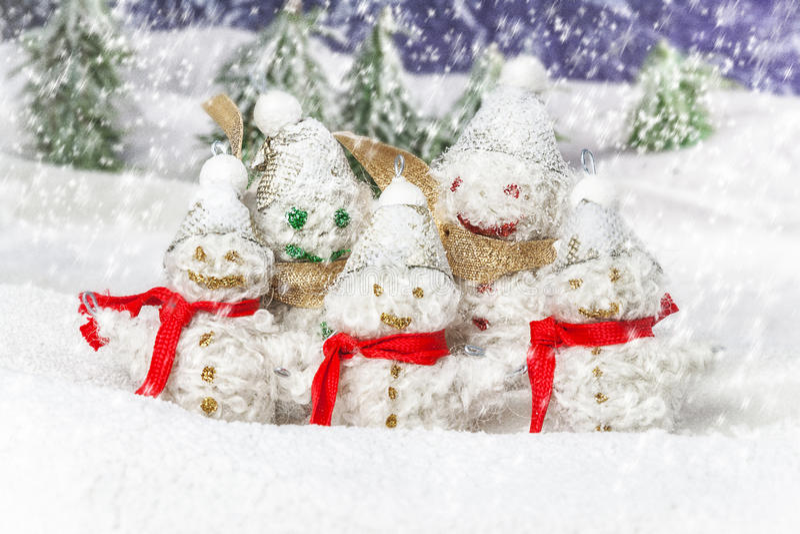 Family is happy snowmen
