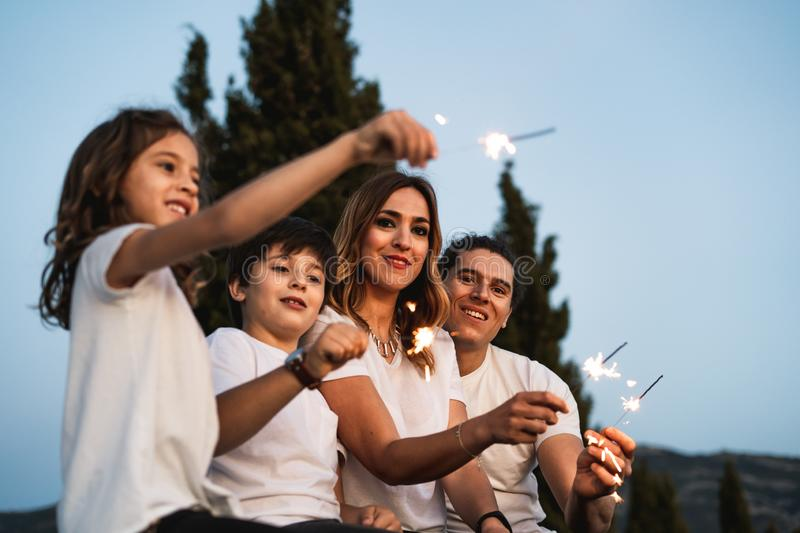 Family with happy sparklers. Family with happy sparkles, Concept family smiling stock image