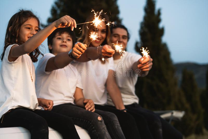 Family with happy sparklers. Family with happy sparkles, Concept family smiling stock images