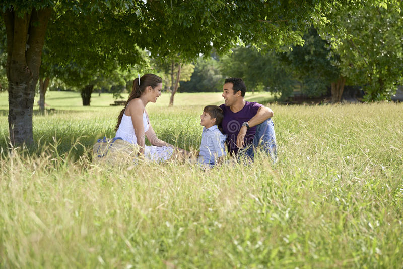 Family with happy young man, woman and child playing royalty free stock photography