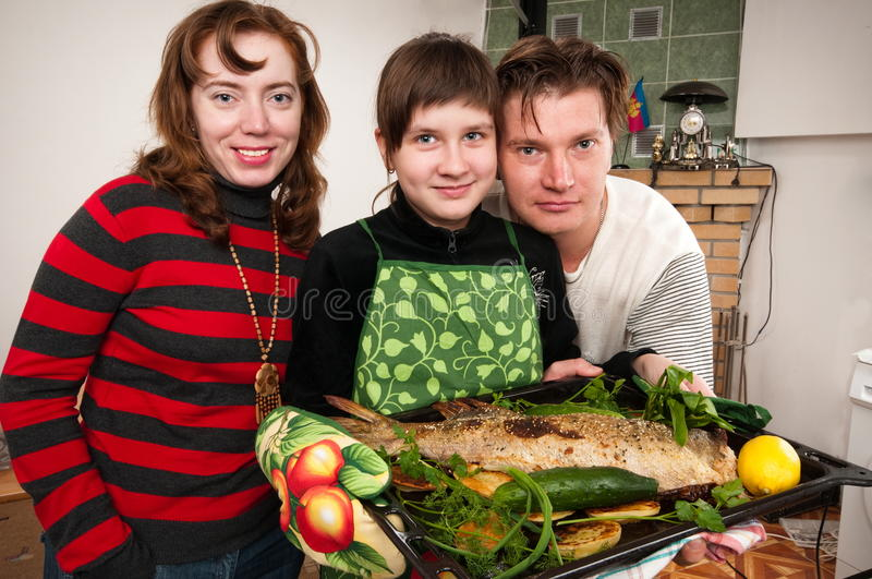 The family has prepared for a supper. Such prepared fish will suffice on all family stock photography