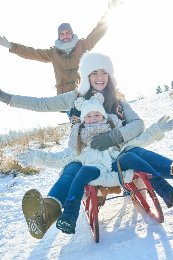 Family have fun in the snow in winter royalty free stock photo