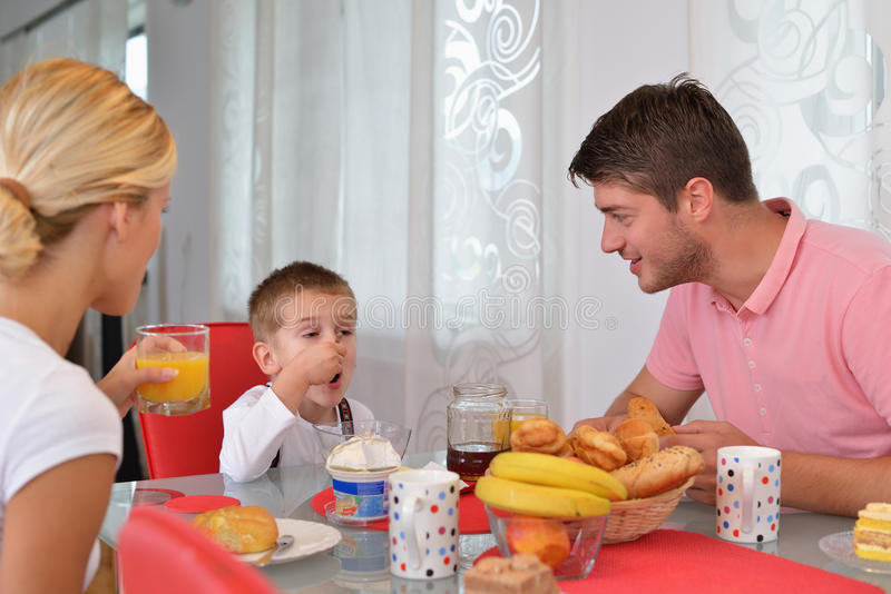 Family have healthy breakfast at home royalty free stock images