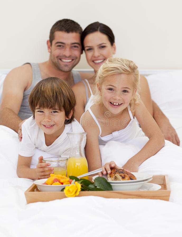 Family Having Breakfast In Bedroom Stock Photography