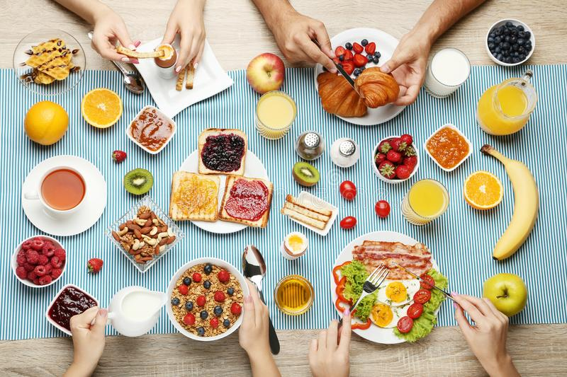 Family having breakfast. Happy family having tasty breakfast in the morning stock photo