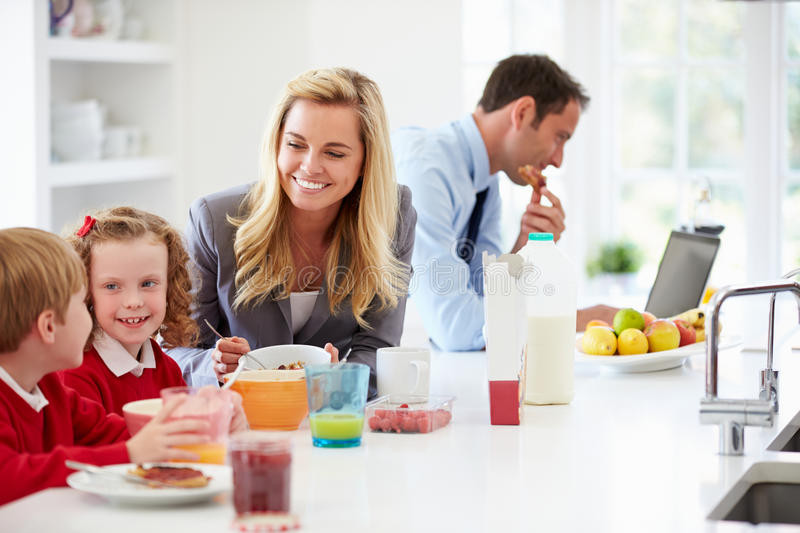 Family Having Breakfast In Kitchen Before School And Work. In The Morning stock images