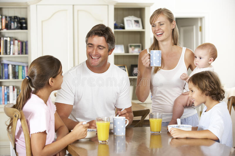 Family Having Breakfast In Kitchen Together stock photography