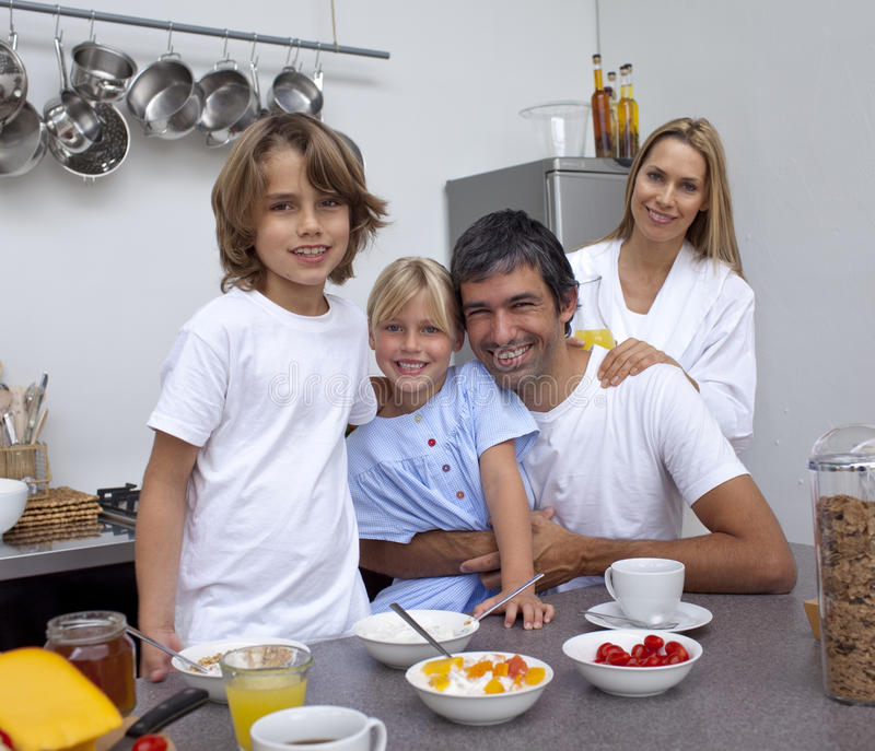 Family having breakfast together. In the kitchen stock image